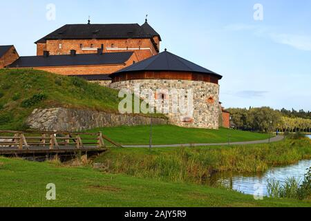 Medieval fortress on coast of picturesque lake Vanajavesi in old Hameenlinna, Finland - Stock Photo