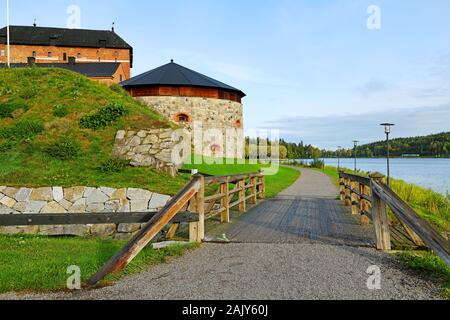 Medieval fortress and bridge on coast of picturesque lake Vanajavesi in old Hameenlinna, Finland - Stock Photo
