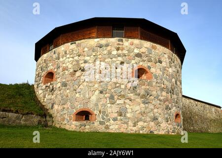 Medieval fortress on coast of famous lake Vanajavesi in old Hameenlinna, Finland. Round gun turret - Stock Photo