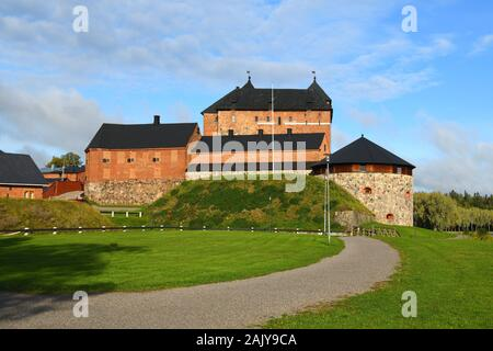 Medieval fortress on coast of picturesque lake Vanajavesi in Linnanpuisto park, Hameenlinna, Finland - Stock Photo