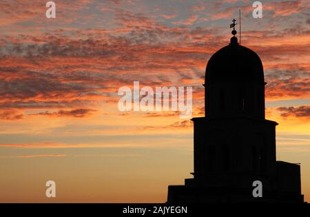Stunning sunset view with silhouette of franciscan church and monastary in Old Town Dubrovnik, Croatia - Stock Photo