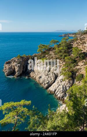 Secluded bay along the hiking trail between Cennet Beach and Kalabantia, Kabak, Fethiye, Aegean Turquoise coast, Anatolia, Turkey, Asia Minor, Eurasia - Stock Photo