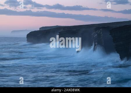Waves crass against cliffs at Yesnaby, Orkney, Scotland - Stock Photo