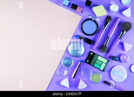 Make up accessory on purple and pink, classic blue - Stock Photo