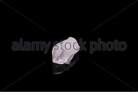 Citrine gemstone isolated on black background. Macro shot. - Stock Photo