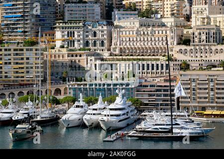 Apartment buildings, luxury yachts and sailing boats in Port Hercules harbour, La Condamine, Principality of Monaco, French Riviera, Europe - Stock Photo