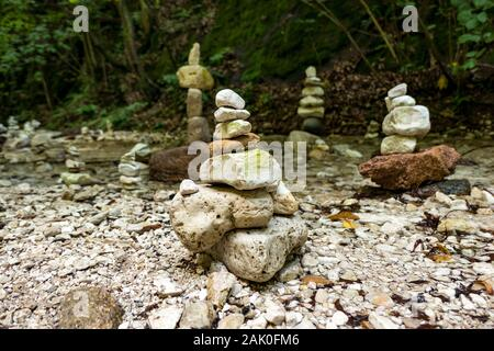 Cairns standing in a river - Stock Photo