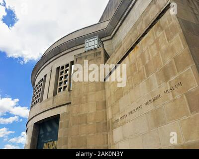 Washington DC, USA - June 22, 2019: United States Holocaust Memorial Museum over cloudscape.