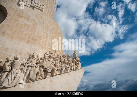 The Padrao dos Descobrimentos or Monument to the Discoveries against blue cloudy sky.