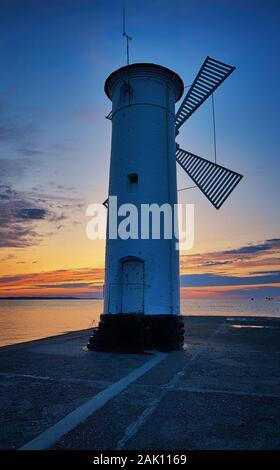 Lighthouse in sunset in Swinemünde on the Baltic Sea. Swinoujscie, Poland - Stock Photo