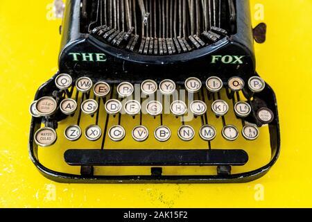 The Fox vintage typewriter on yellow background