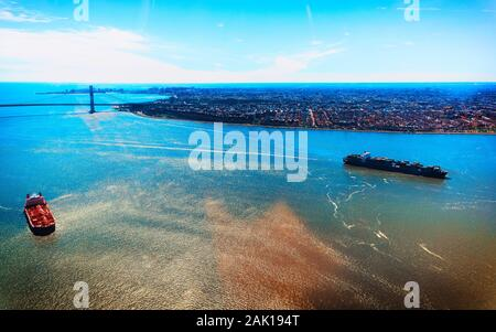 Aerial view on Containers Vessel and Manhattan Bridge New York reflex - Stock Photo