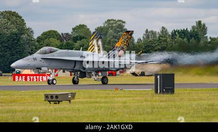 Swiss Air Force McDonnell Douglas F/A-18C Hornet fighter aircraft displaying at the Royal International Air Tattoo, RAF Fairford, UK on 21/7/19. - Stock Photo