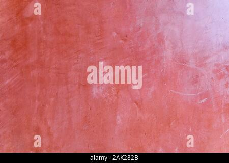 Plastered brick wall painted in red color vintage style background and texture.