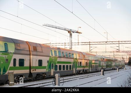 Train at snowy railway station in Oulu Finland - Stock Photo