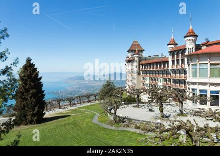 March 2019. Beautiful picture of the SHMS Swiss Hotel Management School in Switzerland (Caux-Montreux). Sunny day, blue sky and luxurious green grass. - Stock Photo