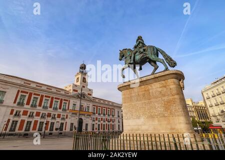 Madrid Spain, city skyline at Puerta del Sol and Clock Tower of Sun Gate with Equestrian Statue of Carlos III - Stock Photo