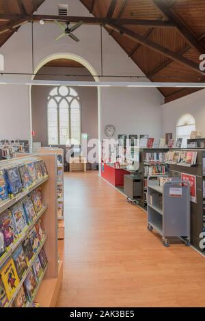 Artarmon Public Library is situated in a former small church with an open timber lined ceiling and exposed roof trusses located on Sydneys north shore - Stock Photo