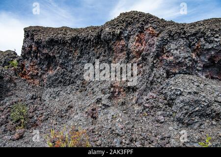 weathered face of the end of a volcanic lava flow on the Big Island, Hawaii - Stock Photo
