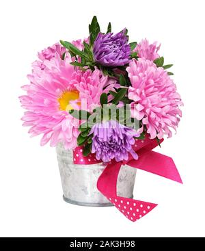Pink and purple aster flowers in a small metal bucket isolated on white - Stock Photo