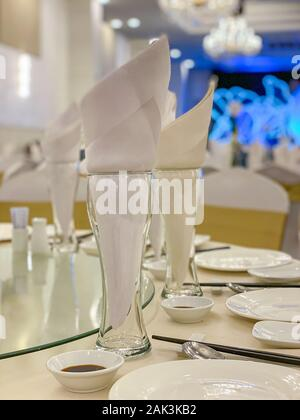Closeup photo of glasses and tableware on banquet table - Stock Photo
