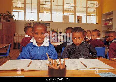 Primary school routine in Plettenberg Bay at the Western Cape. Pupils sit at their tables in the Primary School in the district Harkerville. (undated