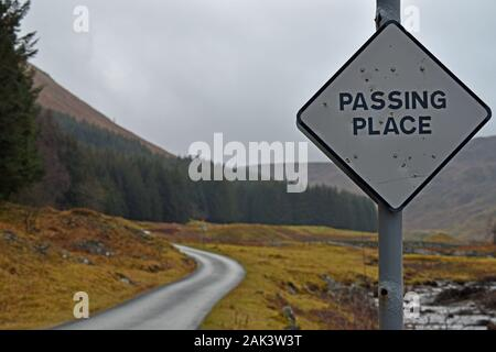 Passing Place sign on single track road in Glen Lyon, Perthshire, Scotland. Road and mountain blurred background. - Stock Photo