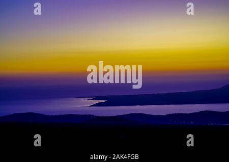 Amazing, awe inspiring Yellow blue and purple sunset. Photographed on the Island of Cephalonia, Ionian Sea, Greece - Stock Photo