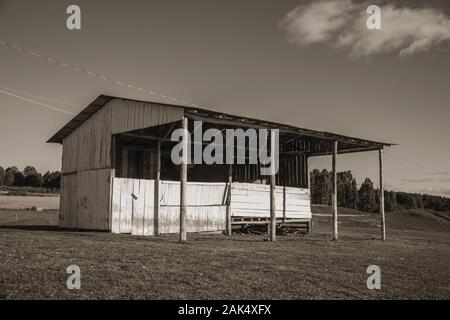 Old wooden livestock shack on rural lowlands called Pampas in a ranch near Cambara do Sul. A town with natural tourist sights in southern Brazil. - Stock Photo