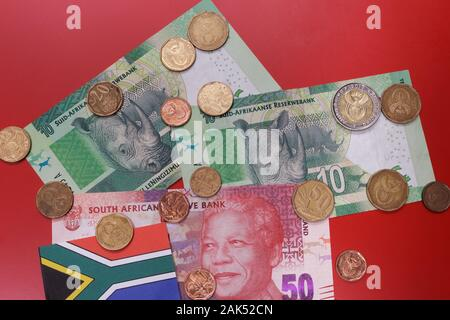 South Africa republic official rand money currency, in denominations of 10 & 50 bills with bimetallic cent coins. ZAR banknotes & coins top view. - Stock Photo