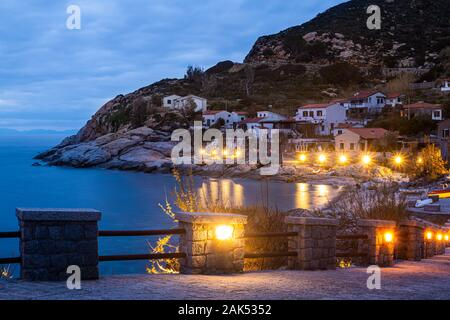 Chiessi, Elba Island, Tuscany, Italy. Beautiful view of the village at sunset. Mediterranean bush, residential houses and hotels with yellow lights il - Stock Photo
