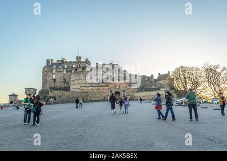 Edinburgh / Scotland / UK - 04/20/2014: Front view at the Edinburgh Castle, tourists and walls fortress, on city of Edinburgh, Scotland - Stock Photo