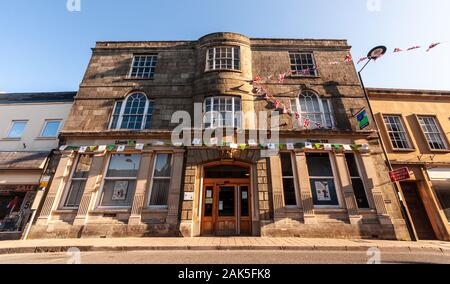 Shaftesbury, England, UK - July 28, 2012: High Street buildings are decorated with bunting to celebrate the London 2012 Olympics in Shaftesbury in Dor - Stock Photo