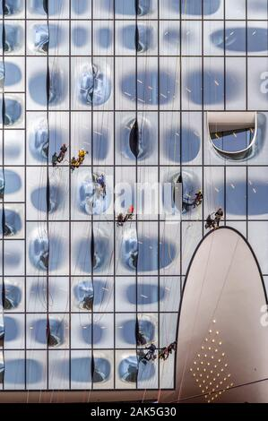 window cleaners at the Elbphilharmonie facade in Hamburg, Germany - Stock Photo
