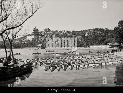 1955 - The Summer Palace (simplified Chinese: 颐和园; traditional Chinese: 頤和園; pinyin: Yíhéyuán), is a vast ensemble of lakes, gardens and palaces in Beijing. It was an imperial garden in the Qing Dynasty. Mainly dominated by Longevity Hill (万寿山; 萬壽山; Wànshòu Shān) and Kunming Lake, it covers an expanse of 2.9 square kilometres (1.1 sq mi), three-quarters of which is water. Longevity Hill is about 60 m (200 ft) high and has many buildings positioned in sequence. The front hill is rich with splendid halls and pavilions, while the back hill, in sharp contrast, is quiet with natural beauty.