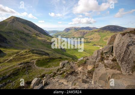 Buttermere village and lake, and Crummock Water, lie in the valley below the mountains of the English Lake District, seen from the peak of Giant Hayst - Stock Photo