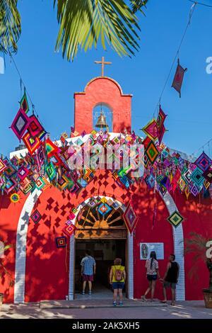 Mexico,Nayarit, Sayulita, Parroquia de Nuestra Señora de Guadalupe- Sayulita, catholic church with Ojos de Dios banners - Stock Photo