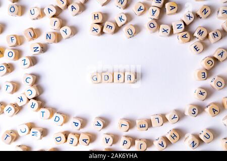 Cubes with letters building the word 'GDPR' in the middle of random cubes laying around - Stock Photo