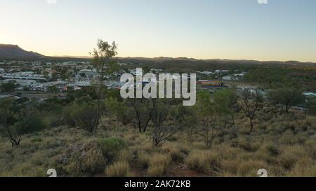 A sunset captured from the Anzac Hill Lookout in Alice Springs, in the Northern Territories in Australia - Stock Photo