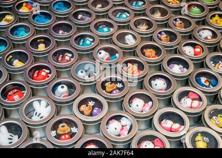 HongKong, China - November, 2019: Usb Stick with toy / cartoon / comic characters  on street market (Ladie`s Market) in Hong Kong , Tung Choi Street