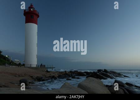 Durban, KwaZulu-Natal, South Africa, landscape, lighthouse on beach of Umhlanga Rocks waterfront at first light, blue sky, African landscapes - Stock Photo