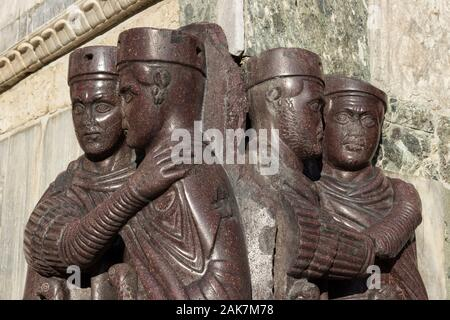 Detail of the faces of the Tetrarchs, a very famous sculptural group outside the Basilica of San Marco, Venice - Stock Photo
