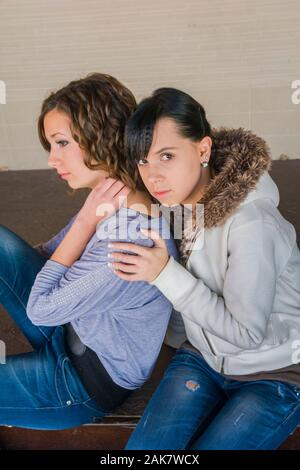 Serious looking at camera eyeshot eye eyes contact sitting hand hands hold holding shoulder three-quarter length sideview side-view - Stock Photo