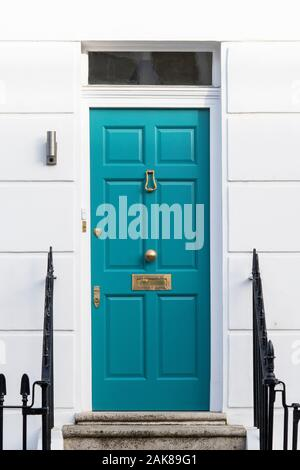 Teal coloured house door. London, England - Stock Photo