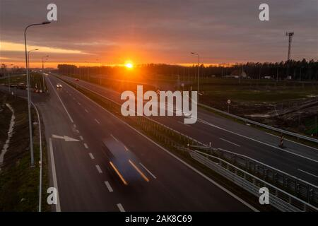 car traffic on the newly built section of the S6 expressway in Poland during sunset