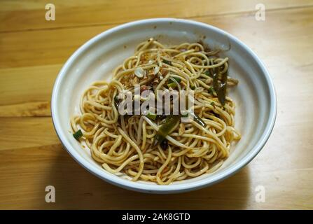 Dan Dan noodle, a spicy Szechuan cuisine dish commonly found in chinese street food. - Stock Photo