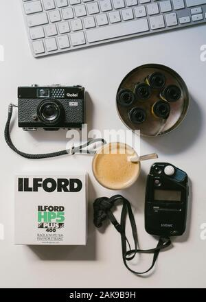 Film photography equipment on a desk - Stock Photo