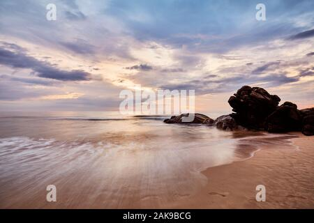 Scenic sunset on the beach, long time exposure, Sri Lanka. - Stock Photo