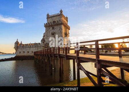 Lisbon, Portugal : Belém Tower view at sunset. The Unesco listed building was designed in 1515 by Francisco de Arruda  to defend the city's harbour. - Stock Photo