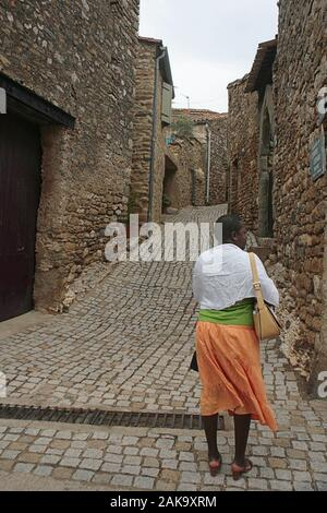 Alley with stone setts (Rue des Martyrs) in the ancient Cathar village of Minerve, Hérault, Occitanie, France - Stock Photo